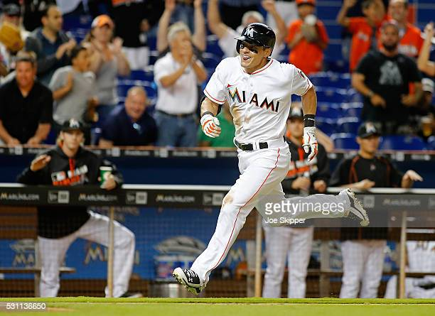 Derek Dietrich of the Miami Marlins runs to score following his seventh inning triple against the Milwaukee Brewers at Marlins Park on May 9 2016 in...