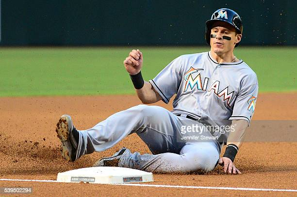 Derek Dietrich of the Miami Marlins safely slides into third base in the first inning against the Arizona Diamondbacks at Chase Field on June 11 2016...
