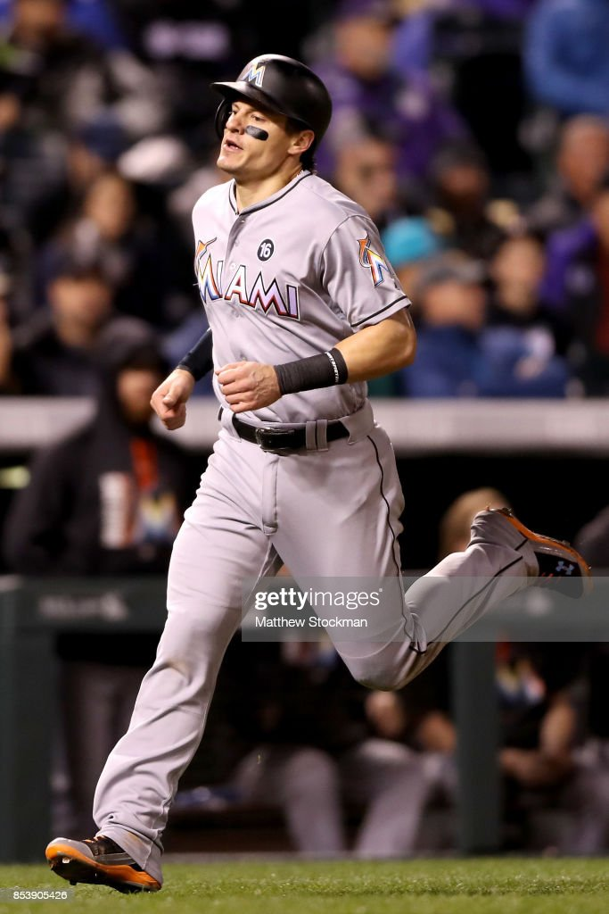Derek Dietrich #32 of the Miami Marlins scores on a Miguel Rojas RBI double in the sixth inning against the Colorado Rockies at Coors Field on September 25, 2017 in Denver, Colorado.