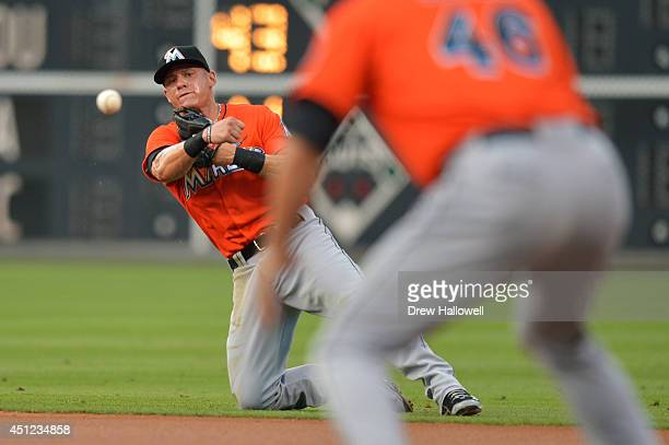Derek Dietrich of the Miami Marlins throws to his teammate Garrett Jones for an out in the first inning against the Philadelphia Phillies at Citizens...