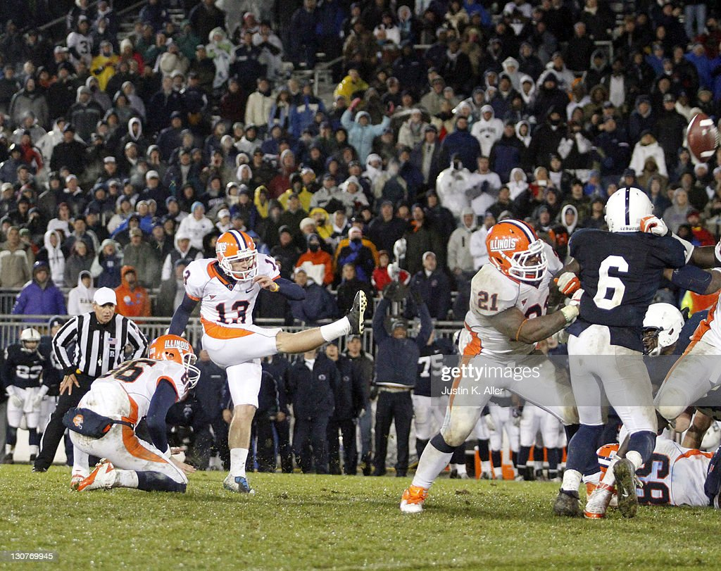 Derek Dimke #13 of the Illinois Fighting Illini kicks a field goal to lose the game against the Penn State Nittany Lions during the game on October 29, 2011 at Beaver Stadium in State College, Pennsylvania. The Nittany Lions defeated the Fighting Illini 10-7.