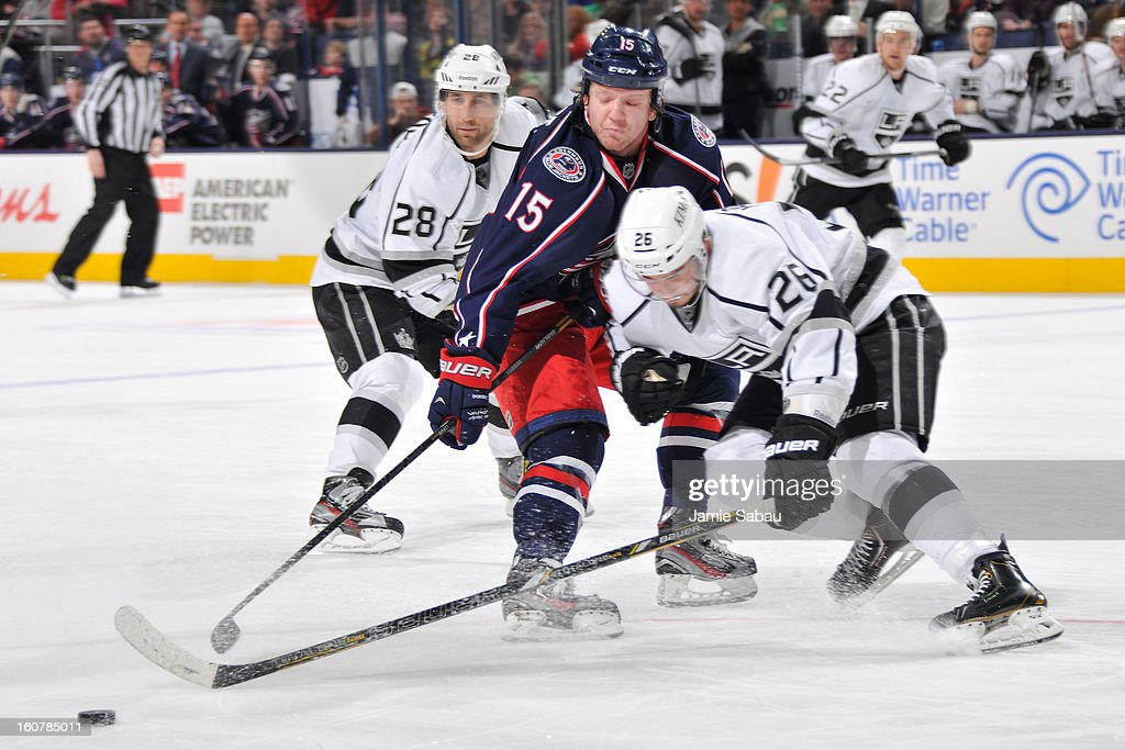 Derek Dorsett #15 of the Columbus Blue Jackets attempts to drag the puck as Slava Voynov #26 of the Los Angeles Kings defends in the third period on February 5, 2013 at Nationwide Arena in Columbus, Ohio. Los Angeles defeated Columbus 4-2.