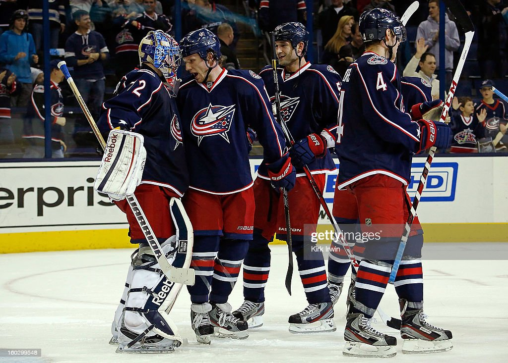 <a gi-track='captionPersonalityLinkClicked' href=/galleries/search?phrase=Derek+Dorsett&family=editorial&specificpeople=4306277 ng-click='$event.stopPropagation()'>Derek Dorsett</a> #15 of the Columbus Blue Jackets congratulates <a gi-track='captionPersonalityLinkClicked' href=/galleries/search?phrase=Sergei+Bobrovsky&family=editorial&specificpeople=4488556 ng-click='$event.stopPropagation()'>Sergei Bobrovsky</a> #72 of the Columbus Blue Jackets after defeating the Dallas Stars 2-1 on January 28, 2013 at Nationwide Arena in Columbus, Ohio. Columbus defeated Dallas 2-1.