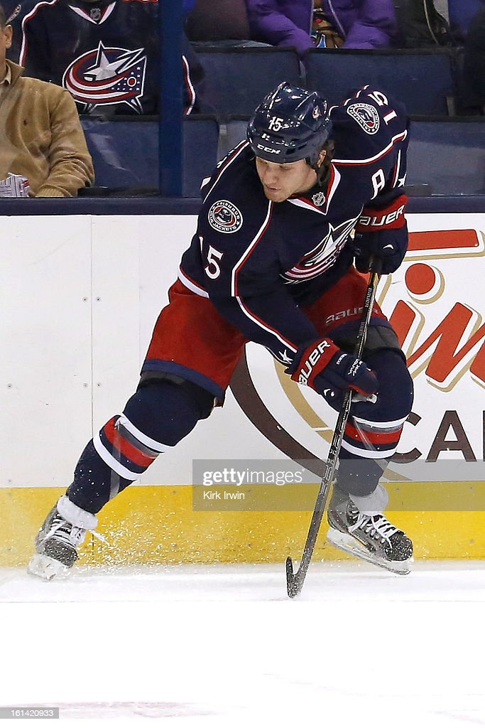 Derek Dorsett #15 of the Columbus Blue Jackets controls the puck during the game against the Calgary Flames on February 7, 2013 at Nationwide Arena in Columbus, Ohio.