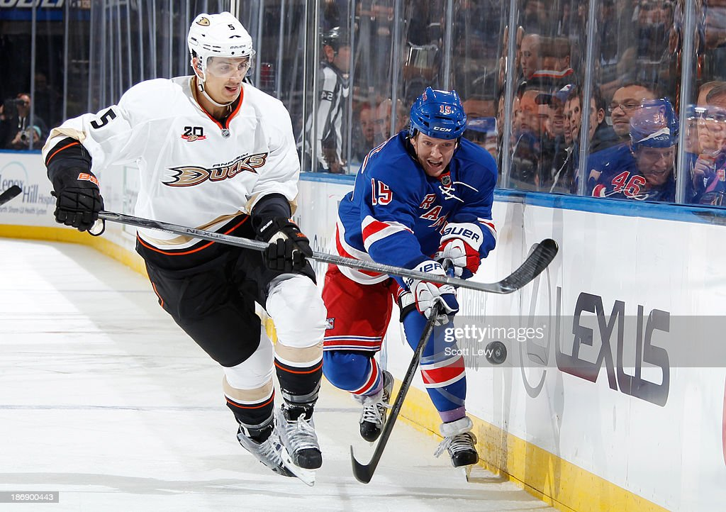 <a gi-track='captionPersonalityLinkClicked' href=/galleries/search?phrase=Derek+Dorsett&family=editorial&specificpeople=4306277 ng-click='$event.stopPropagation()'>Derek Dorsett</a> #15 of the New York Rangers and <a gi-track='captionPersonalityLinkClicked' href=/galleries/search?phrase=Luca+Sbisa&family=editorial&specificpeople=4893043 ng-click='$event.stopPropagation()'>Luca Sbisa</a> #5 of the Anaheim Ducks battle for the puck at Madison Square Garden on November 4, 2013 in New York City.