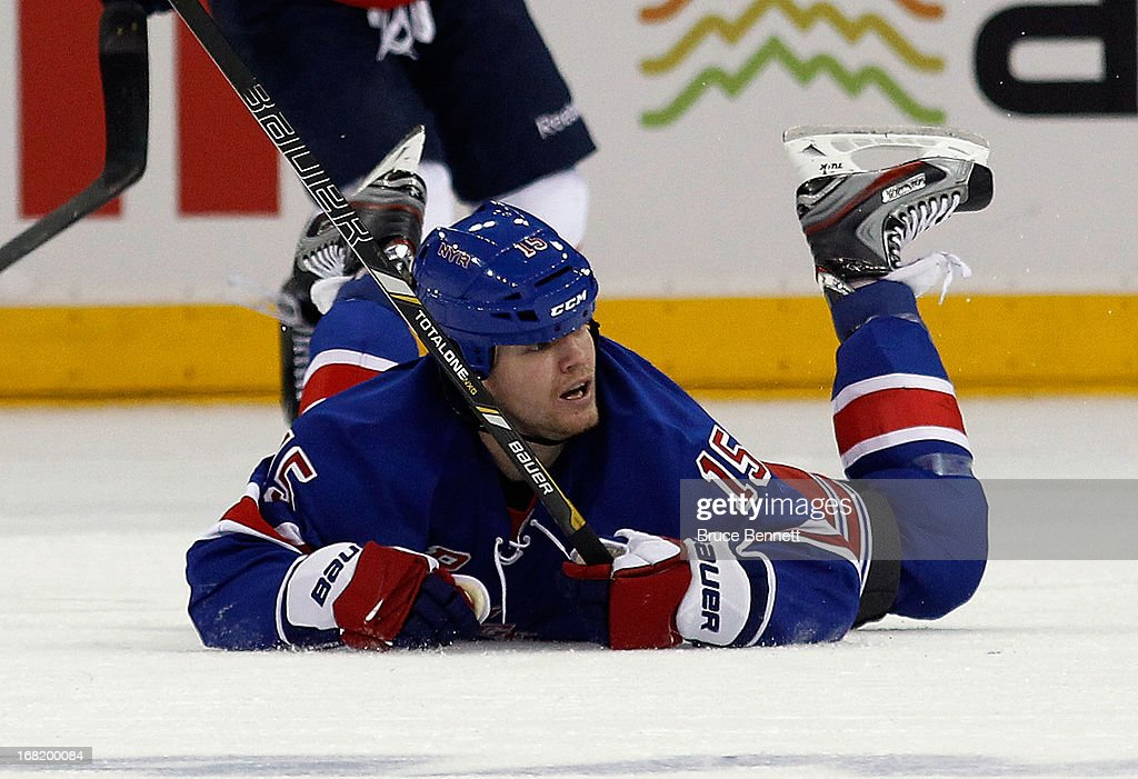 <a gi-track='captionPersonalityLinkClicked' href=/galleries/search?phrase=Derek+Dorsett&family=editorial&specificpeople=4306277 ng-click='$event.stopPropagation()'>Derek Dorsett</a> #15 of the New York Rangers collides with Martin Erat #10 of the Washington Capitals in Game Three of the Eastern Conference Quarterfinals during the 2013 NHL Stanley Cup Playoffs at Madison Square Garden on May 6, 2013 in New York City. The Rangers defeated the Capitals 4-3.