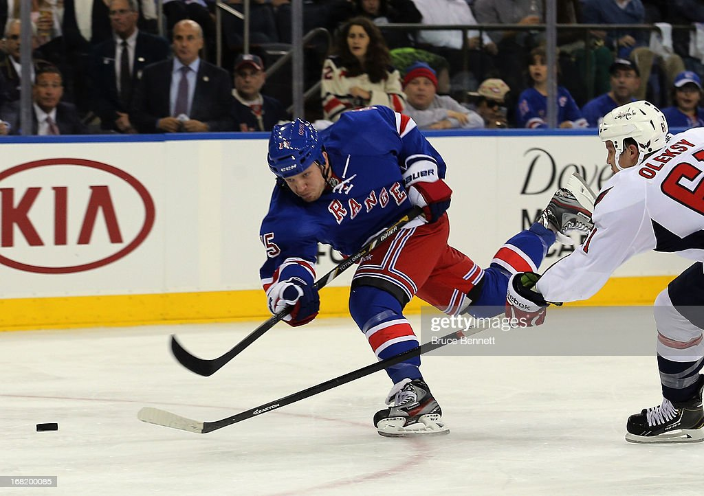 <a gi-track='captionPersonalityLinkClicked' href=/galleries/search?phrase=Derek+Dorsett&family=editorial&specificpeople=4306277 ng-click='$event.stopPropagation()'>Derek Dorsett</a> #15 of the New York Rangers fires a shot against the Washington Capitals in Game Three of the Eastern Conference Quarterfinals during the 2013 NHL Stanley Cup Playoffs at Madison Square Garden on May 6, 2013 in New York City. The Rangers defeated the Capitals 4-3.