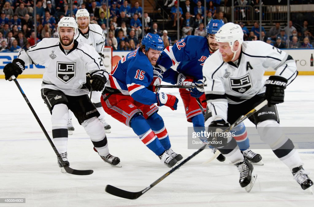 <a gi-track='captionPersonalityLinkClicked' href=/galleries/search?phrase=Derek+Dorsett&family=editorial&specificpeople=4306277 ng-click='$event.stopPropagation()'>Derek Dorsett</a> #15 of the New York Rangers gets tangled with teammate Brian Boyle #22 while chasing Matt Greene #2 of the Los Angeles Kings in the first period of Game Three of the 2014 Stanley Cup Final at Madison Square Garden on June 9, 2014 in New York City.