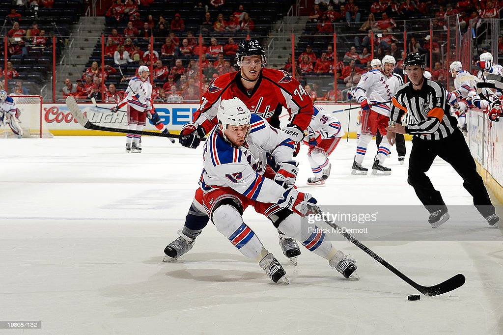 <a gi-track='captionPersonalityLinkClicked' href=/galleries/search?phrase=Derek+Dorsett&family=editorial&specificpeople=4306277 ng-click='$event.stopPropagation()'>Derek Dorsett</a> #15 of the New York Rangers handles the puck in the third period of Game Seven of the Eastern Conference Quarterfinals during the 2013 NHL Stanley Cup Playoffs at Verizon Center on May 13, 2013 in Washington, DC.
