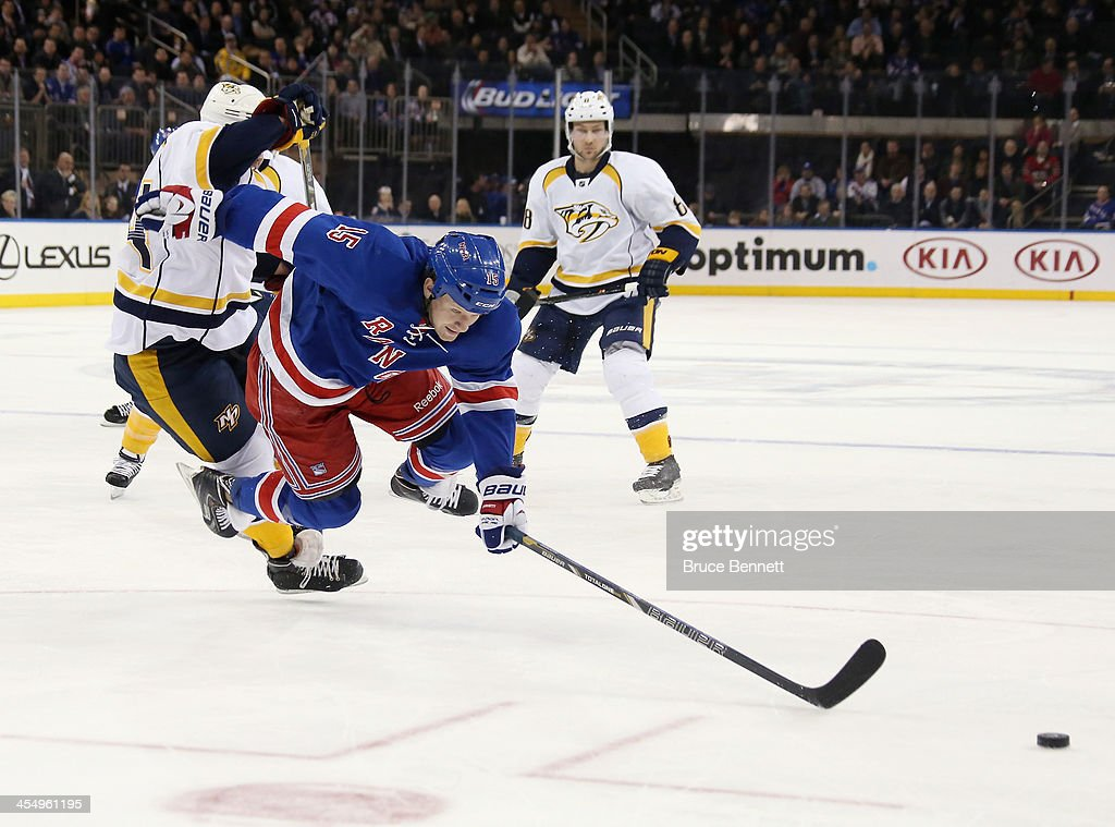<a gi-track='captionPersonalityLinkClicked' href=/galleries/search?phrase=Derek+Dorsett&family=editorial&specificpeople=4306277 ng-click='$event.stopPropagation()'>Derek Dorsett</a> #15 of the New York Rangers is checked by <a gi-track='captionPersonalityLinkClicked' href=/galleries/search?phrase=Victor+Bartley&family=editorial&specificpeople=570430 ng-click='$event.stopPropagation()'>Victor Bartley</a> #64 of the Nashville Predators during the second period at Madison Square Garden on December 10, 2013 in New York City.