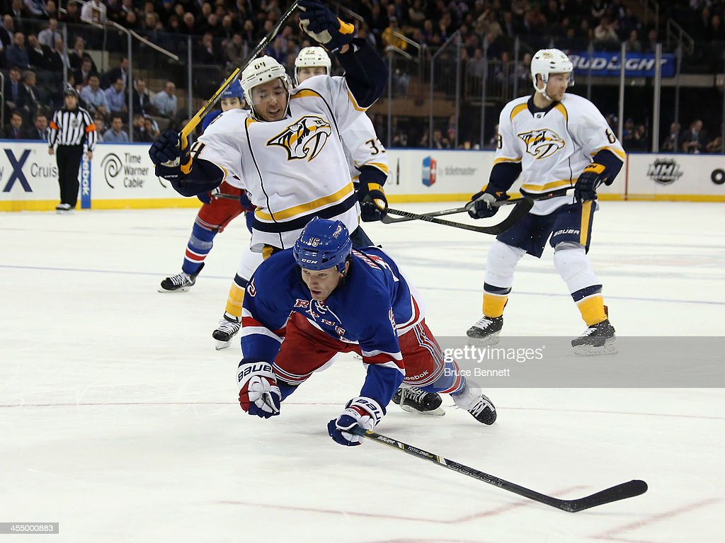 <a gi-track='captionPersonalityLinkClicked' href=/galleries/search?phrase=Derek+Dorsett&family=editorial&specificpeople=4306277 ng-click='$event.stopPropagation()'>Derek Dorsett</a> #15 of the New York Rangers is checked by <a gi-track='captionPersonalityLinkClicked' href=/galleries/search?phrase=Victor+Bartley&family=editorial&specificpeople=570430 ng-click='$event.stopPropagation()'>Victor Bartley</a> #64 of the Nashville Predators during the second period at Madison Square Garden on December 10, 2013 in New York City. The Predators defeated the Rangers 4-1.