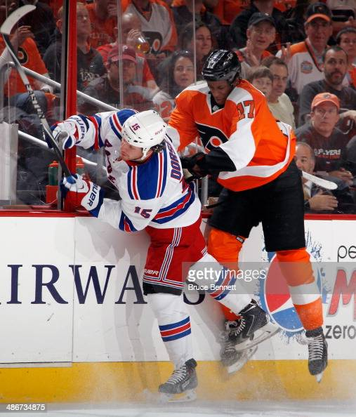 Derek Dorsett of the New York Rangers is hit by Wayne Simmonds of the Philadelphia Flyers during the second period in Game Four of the First Round of...