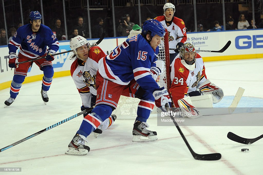 <a gi-track='captionPersonalityLinkClicked' href=/galleries/search?phrase=Derek+Dorsett&family=editorial&specificpeople=4306277 ng-click='$event.stopPropagation()'>Derek Dorsett</a> #15 of the New York Rangers looks for a shot on goal against Tim Thomas #34 of the Florida Panthers during the second period at Madison Square Garden on November 10, 2013 in New York City. The Rangers defeat the Panthers 4-3.