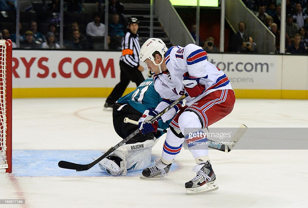 <a gi-track='captionPersonalityLinkClicked' href=/galleries/search?phrase=Derek+Dorsett&family=editorial&specificpeople=4306277 ng-click='$event.stopPropagation()'>Derek Dorsett</a> #15 of the New York Rangers scores a goal, getting past goalkeeper <a gi-track='captionPersonalityLinkClicked' href=/galleries/search?phrase=Antti+Niemi&family=editorial&specificpeople=213913 ng-click='$event.stopPropagation()'>Antti Niemi</a> #31 of the San Jose Sharks during the third period at SAP Center on October 8, 2013 in San Jose, California. The Sharks won the game 9-2.