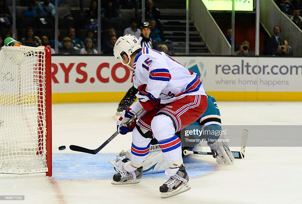 <a gi-track='captionPersonalityLinkClicked' href=/galleries/search?phrase=Derek+Dorsett&family=editorial&specificpeople=4306277 ng-click='$event.stopPropagation()'>Derek Dorsett</a> #15 of the New York Rangers scores a goal, getting past goalkeeper <a gi-track='captionPersonalityLinkClicked' href=/galleries/search?phrase=Antti+Niemi&family=editorial&specificpeople=213913 ng-click='$event.stopPropagation()'>Antti Niemi</a> #31 of the San Jose Sharks during the third period at SAP Center on October 8, 2013 in San Jose, California.