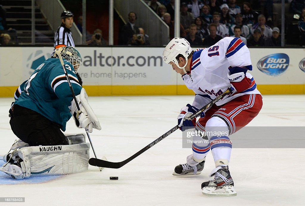 Derek Dorsett #15 of the New York Rangers scores a goal, getting past goalkeeper Antti Niemi #31 of the San Jose Sharks during the third period at SAP Center on October 8, 2013 in San Jose, California.