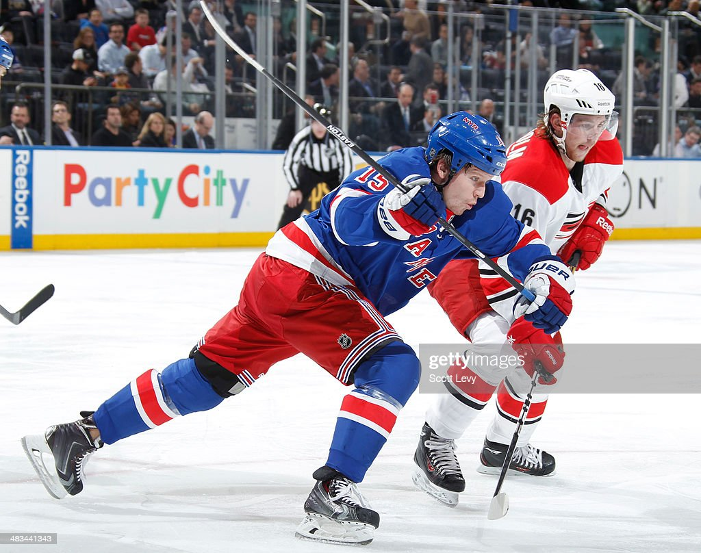 <a gi-track='captionPersonalityLinkClicked' href=/galleries/search?phrase=Derek+Dorsett&family=editorial&specificpeople=4306277 ng-click='$event.stopPropagation()'>Derek Dorsett</a> #15 of the New York Rangers skates against <a gi-track='captionPersonalityLinkClicked' href=/galleries/search?phrase=Elias+Lindholm&family=editorial&specificpeople=8613151 ng-click='$event.stopPropagation()'>Elias Lindholm</a> #16 of the Carolina Hurricanes at Madison Square Garden on April 08, 2014 in New York City.