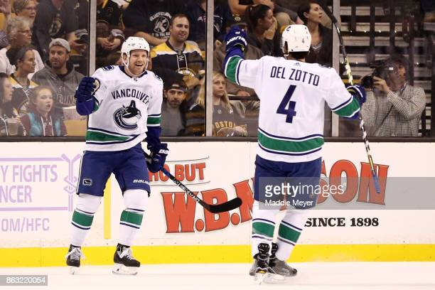 Derek Dorsett of the Vancouver Canucks celebrates with Michael Del Zotto after scoring a goal against the Boston Bruins during the first period at TD...