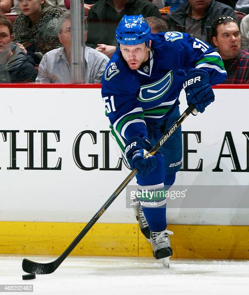 Derek Dorsett of the Vancouver Canucks passes the puck up ice during their NHL game against the St Louis Blues at Rogers Arena March 1 2015 in...