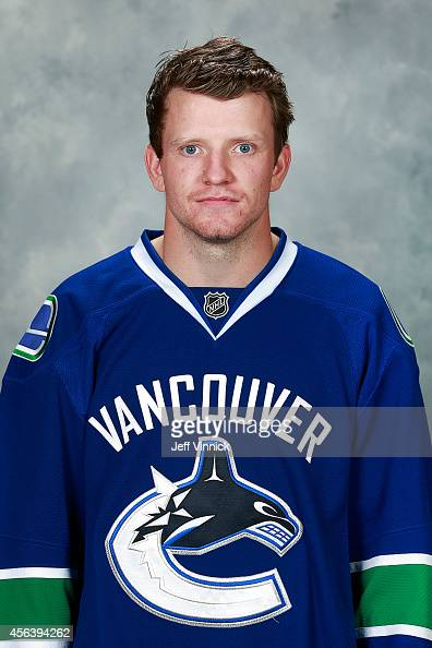 Derek Dorsett of the Vancouver Canucks poses for his official headshot for the 20142015 season on September 18 2014 at the Rogers Arena in Vancouver...