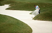 Derek Fathauer plays a shot from a bunker on the fourth hole during round three of THE PLAYERS Championship at the TPC Sawgrass Stadium course on May...