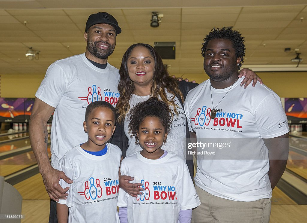 Derek Fisher #6 and family join Russell Westbrook #0 of the Oklahoma City Thunder at his annual Why Not Foundation fundraiser to benefit the Boys and Girls Club at AMC Boulevard Bowl in Edmond, Oklahoma.