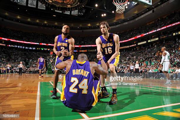Derek Fisher and Pau Gasol helps Kobe Bryant of the Los Angeles Lakers up against the Boston Celtics in Game Five of the 2010 NBA Finals on June 13...