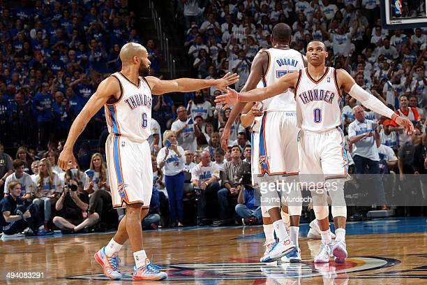 Derek Fisher and Russell Westbrook of the Oklahoma City Thunder celebrate during a game against the San Antonio Spurs in Game Four of the Western...