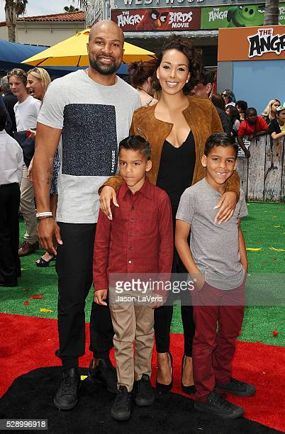 Derek Fisher Gloria Govan and sons Carter Kelly Barnes and Isaiah Michael Barnes attend the premiere of 'Angry Birds' at Regency Village Theatre on...