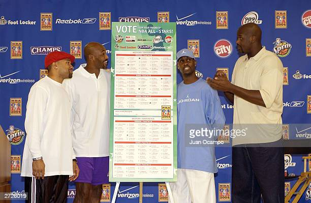 Derek Fisher Karl Malone Gary Payton and Shaquille O'Neal of the Los Angeles Lakers stand next to an oversized replica of a 2004 AllStar ballot as...