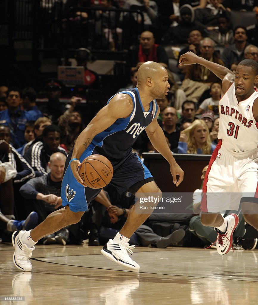 <a gi-track='captionPersonalityLinkClicked' href=/galleries/search?phrase=Derek+Fisher&family=editorial&specificpeople=201724 ng-click='$event.stopPropagation()'>Derek Fisher</a> #6 of the Dallas Mavericks drives to the basket around <a gi-track='captionPersonalityLinkClicked' href=/galleries/search?phrase=Terrence+Ross&family=editorial&specificpeople=6781663 ng-click='$event.stopPropagation()'>Terrence Ross</a> #31 of the Toronto Raptors on December 14, 2012 at the Air Canada Centre in Toronto, Ontario, Canada.