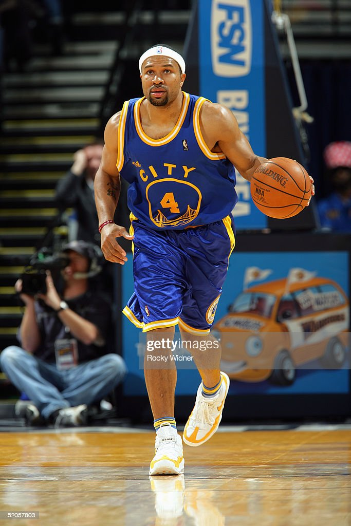 derek-fisher-of-the-golden-state-warriors-brings-the-ball-upcourt-picture-id52057803