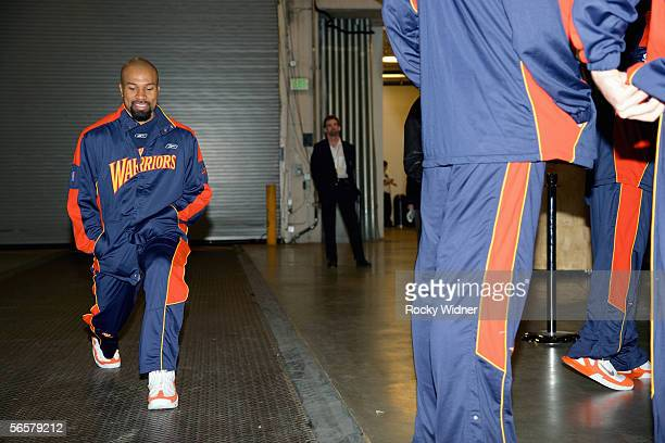Derek Fisher of the Golden State Warriors walks in the tunnel during pregame warmups prior to the Warriors' game against the Seattle SuperSonics...