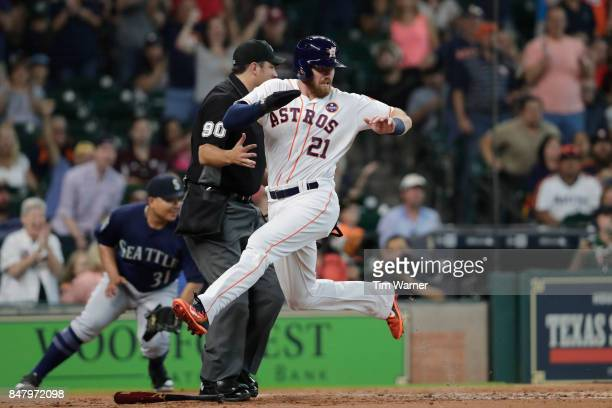 Derek Fisher of the Houston Astros scores a run in the second inning against the Seattle Mariners at Minute Maid Park on September 16 2017 in Houston...