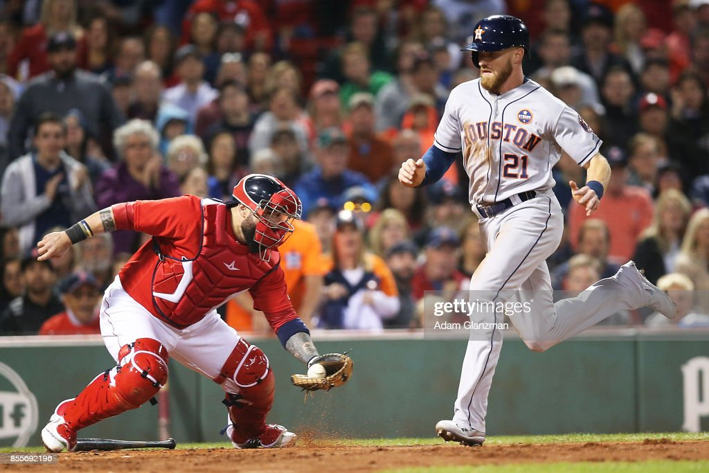 Derek Fisher #21 of the Houston Astros scores past the tag of Sandy Leon #3 of the Boston Red Sox in the third inning of a game at Fenway Park on September 29, 2017 in Boston, Massachusetts.