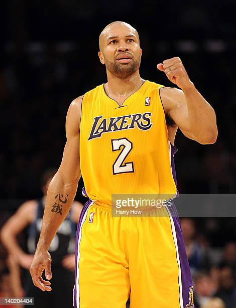 Derek Fisher of the Los Angeles Lakers celebrates a score against the Minnesota Timberwolves during a 10584 win at Staples Center on February 29 2012...