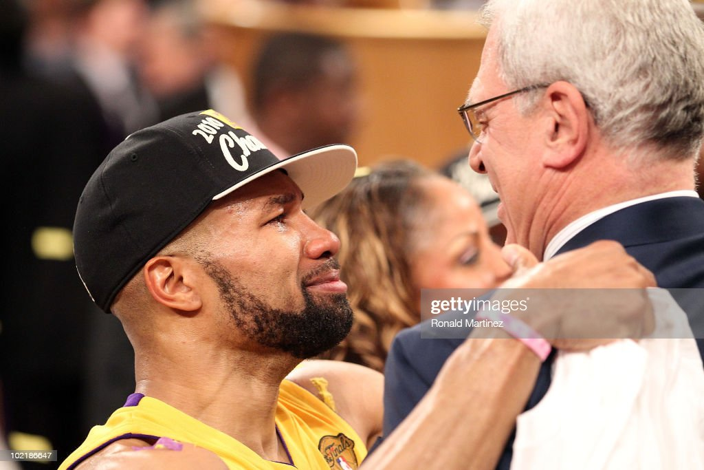 <a gi-track='captionPersonalityLinkClicked' href=/galleries/search?phrase=Derek+Fisher&family=editorial&specificpeople=201724 ng-click='$event.stopPropagation()'>Derek Fisher</a> #2 of the Los Angeles Lakers celebrates with head coach <a gi-track='captionPersonalityLinkClicked' href=/galleries/search?phrase=Phil+Jackson&family=editorial&specificpeople=201756 ng-click='$event.stopPropagation()'>Phil Jackson</a> after the Lakers defeated the Boston Celtics in Game Seven of the 2010 NBA Finals at Staples Center on June 17, 2010 in Los Angeles, California.