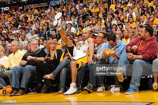 Derek Fisher of the Los Angeles Lakers falls into the courtside seats during a game against the New Orleans Hornets in Game One of the Western...
