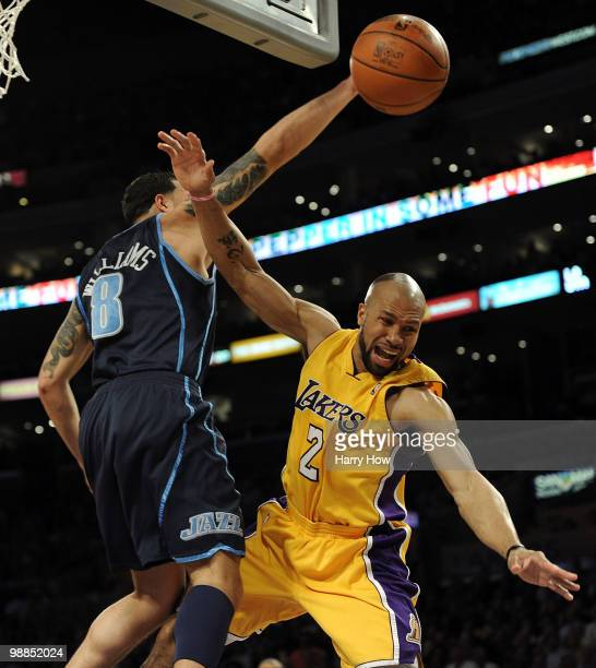 Derek Fisher of the Los Angeles Lakers flies through the air against Deron Williams of the Utah Jazz in the first half during Game Two of the Western...