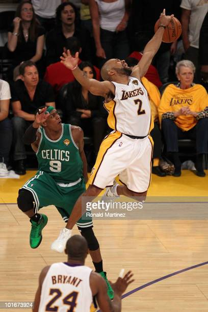 Derek Fisher of the Los Angeles Lakers loses the ball against Rajon Rondo of the Boston Celtics in Game Two of the 2010 NBA Finals at Staples Center...