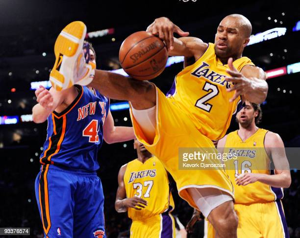 Derek Fisher of the Los Angeles Lakers pulls down a rebound against David Lee of the znew York Knicks during the second quarter of the NBA game at...