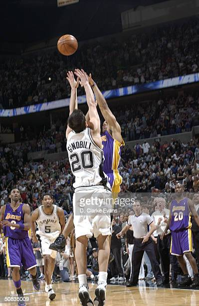 Derek Fisher of the Los Angeles Lakers shoots and makes the gamewinning basket against Emanuel Ginobili of the San Antonio Spurs at the buzzer in...