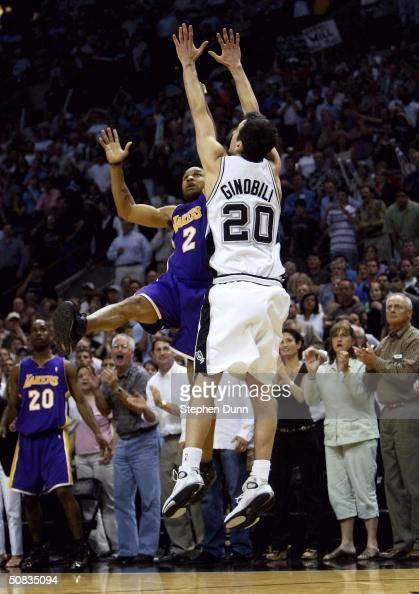 Derek Fisher of the Los Angeles Lakers shoots and makes the gamewinning shot at the buzzer over Emanuel Ginobili of the San Antonio Spurs during game...
