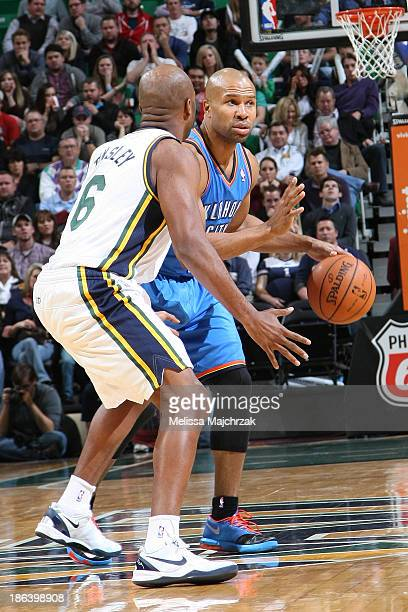 Derek Fisher of the Oklahoma City Thunder dribbles against Jamaal Tinsley of the Utah Jazz at EnergySolutions Arena on October 30 2013 in Salt Lake...