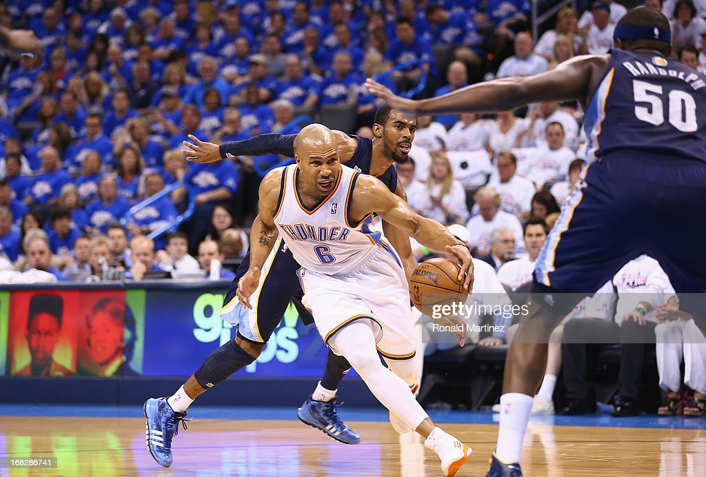 Derek Fisher #6 of the Oklahoma City Thunder dribbles the ball against Mike Conley #11 of the Memphis Grizzlies during Game Two of the Western Conference Semifinals of the 2013 NBA Playoffs at Chesapeake Energy Arena on May 7, 2013 in Oklahoma City, Oklahoma.
