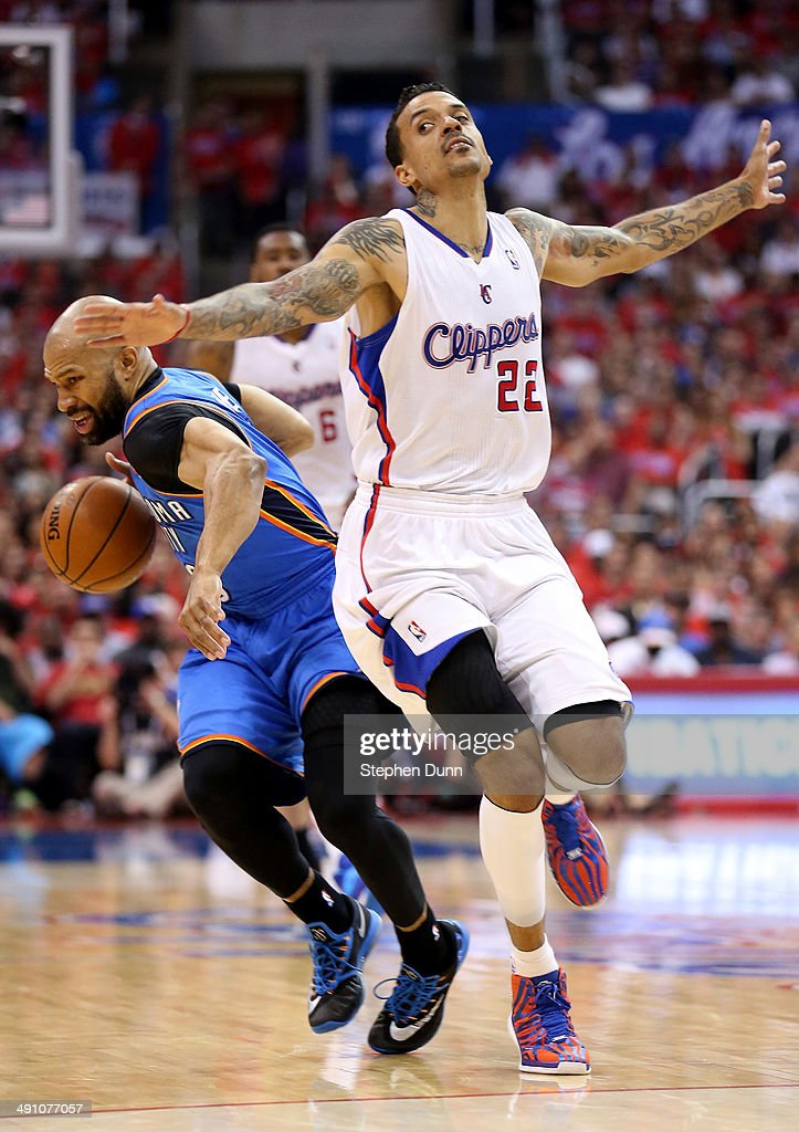 Derek Fisher of the Oklahoma City Thunder drives against Matt Barnes of the Los Angeles Clippers in Game Six of the Western Conference Semifinals...