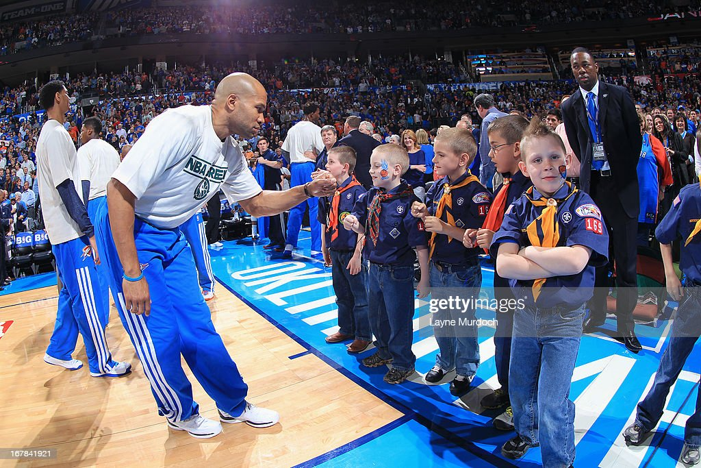 <a gi-track='captionPersonalityLinkClicked' href=/galleries/search?phrase=Derek+Fisher&family=editorial&specificpeople=201724 ng-click='$event.stopPropagation()'>Derek Fisher</a> #6 of the Oklahoma City Thunder high fives fans before the game against the San Antonio Spurs on April 4, 2013 at the Chesapeake Energy Arena in Oklahoma City, Oklahoma.