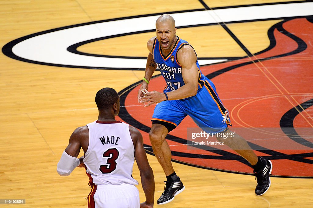 Derek Fisher #37 of the Oklahoma City Thunder reacts towards Dwyane Wade #3 of the Miami Heat in the second half of Game Three of the 2012 NBA Finals on June 17, 2012 at American Airlines Arena in Miami, Florida.