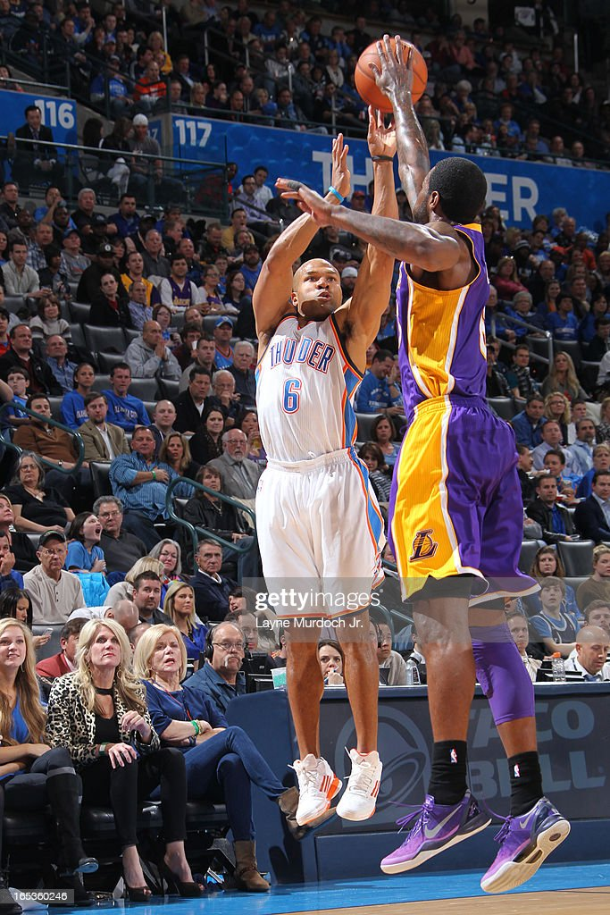 <a gi-track='captionPersonalityLinkClicked' href=/galleries/search?phrase=Derek+Fisher&family=editorial&specificpeople=201724 ng-click='$event.stopPropagation()'>Derek Fisher</a> #6 of the Oklahoma City Thunder takes a shot against Earl Clark #6 of the Los Angeles Lakers on March 05, 2013 at the Chesapeake Energy Arena in Oklahoma City, Oklahoma.