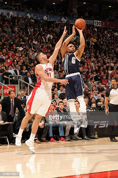 Derek Fisher of the Oklahoma City Thunder takes a shot against the Toronto Raptors on March 21 2014 at the Air Canada Centre in Toronto Ontario...